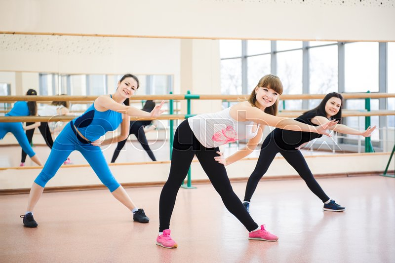 Group of people at the gym in the stretching class, stock photo