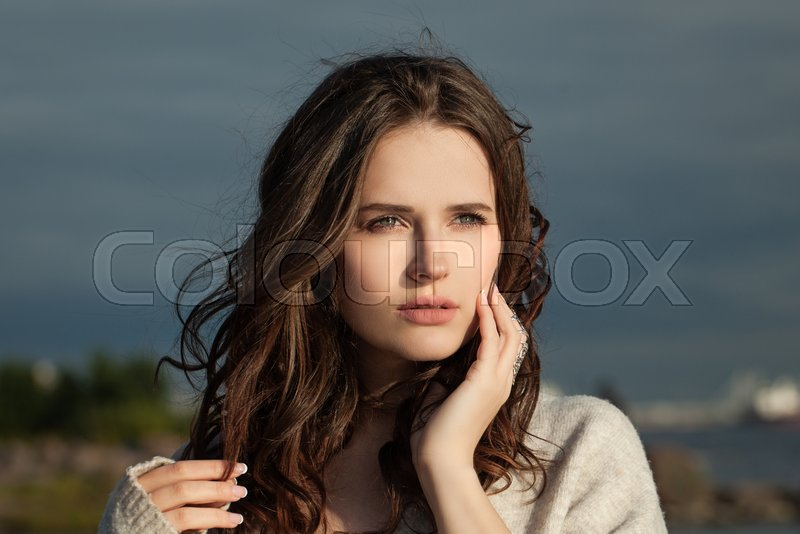 Nice woman outdoor portrait on nature landscape background, stock photo