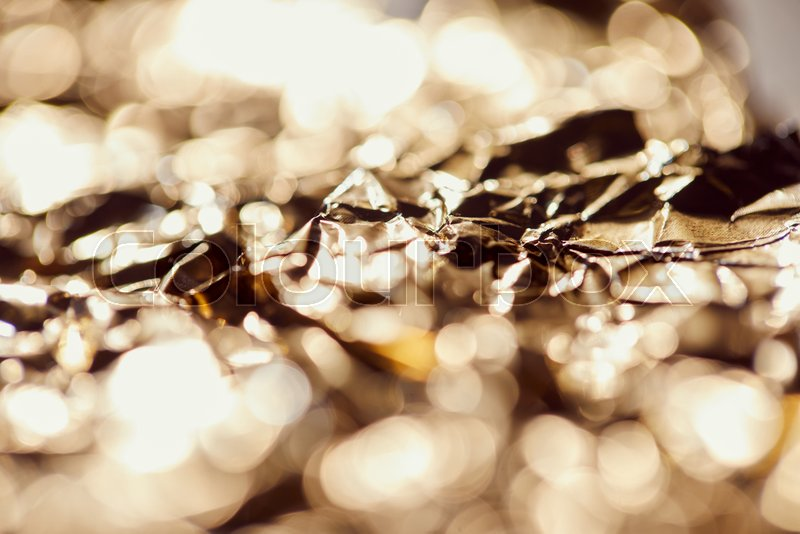 Selrctive focus of foil with sparkling lights and twinkles, stock photo