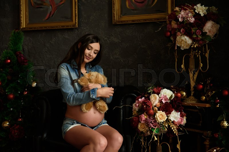 Pregnancy, motherhood, people and expectation concept - close up of happy pregnant woman with big belly, stock photo