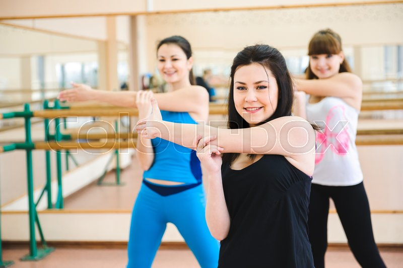 Group of people at the gym in a stretching class, stock photo
