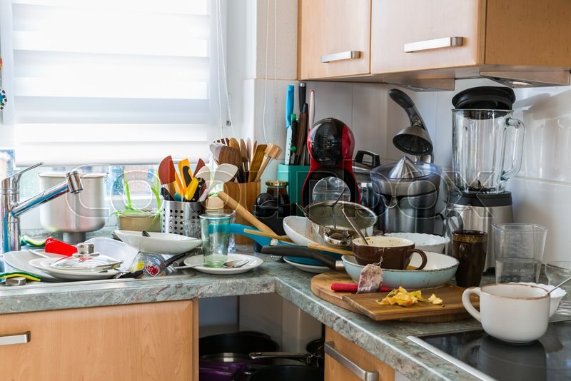 Compulsive Hoarding Syndrom - messy kitchen with pile of dirty dishes, stock photo