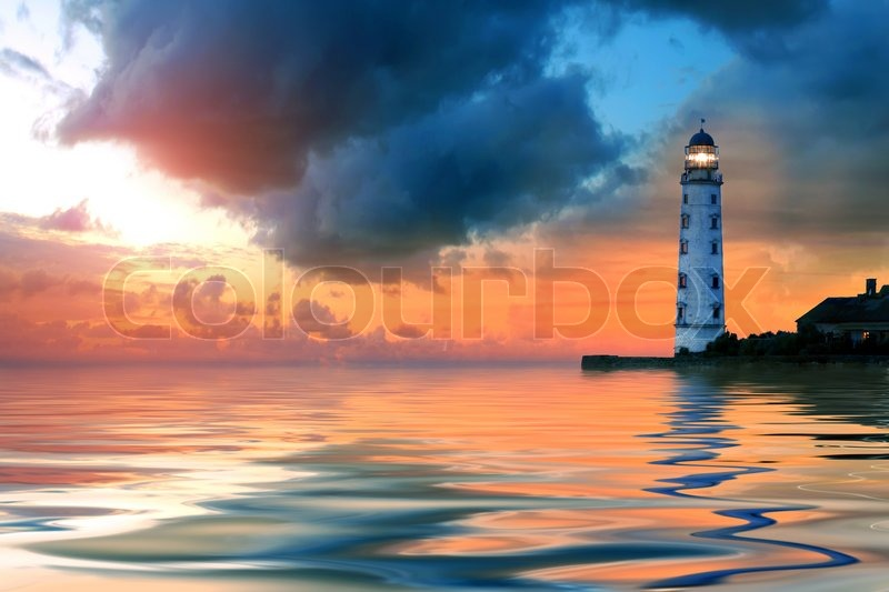 Beautiful nightly seascape with lighthouse and moody sky at the sunset, stock photo
