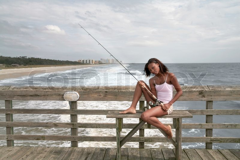Woman Fishing On The Pier Stock Photo Colourbox