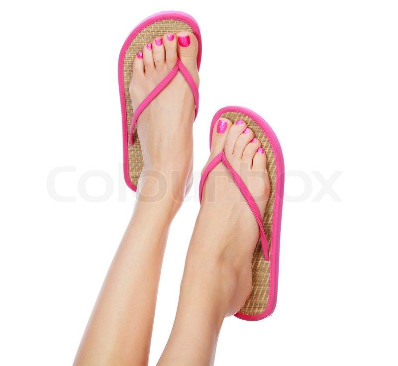 Lustige rosa Sandalen an weibliche Füße | Stockfoto | Colourbox