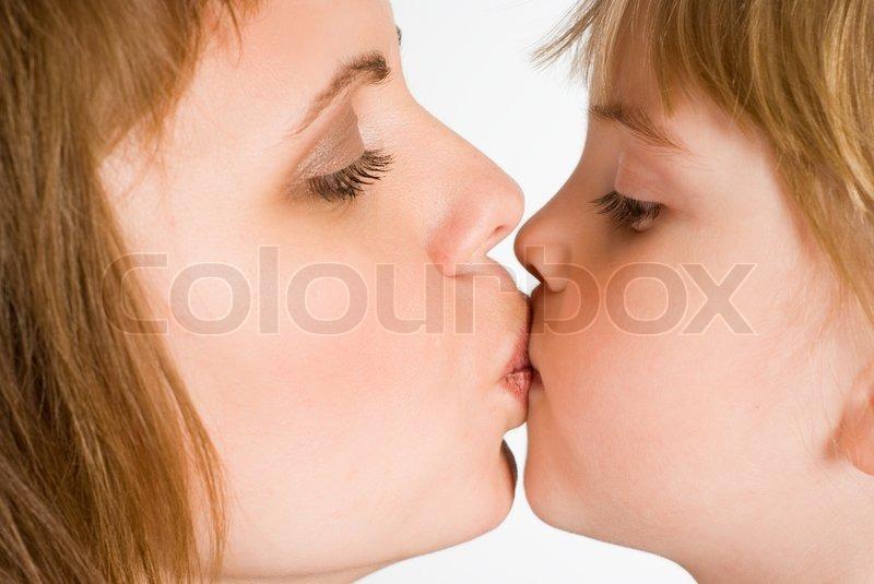 Boy kissing girl on lips in a bath tom