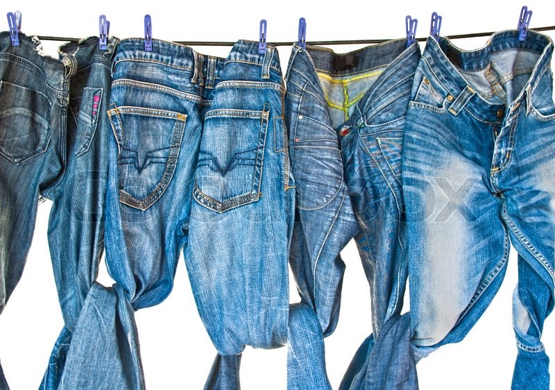 Some Blue Jeans Drying On Washing Line Stock Photo