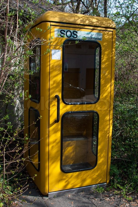 Old Fashioned German Phone Booth Surrounded By Bushes