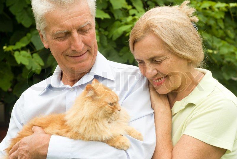 Elderly couple with cat, stock photo