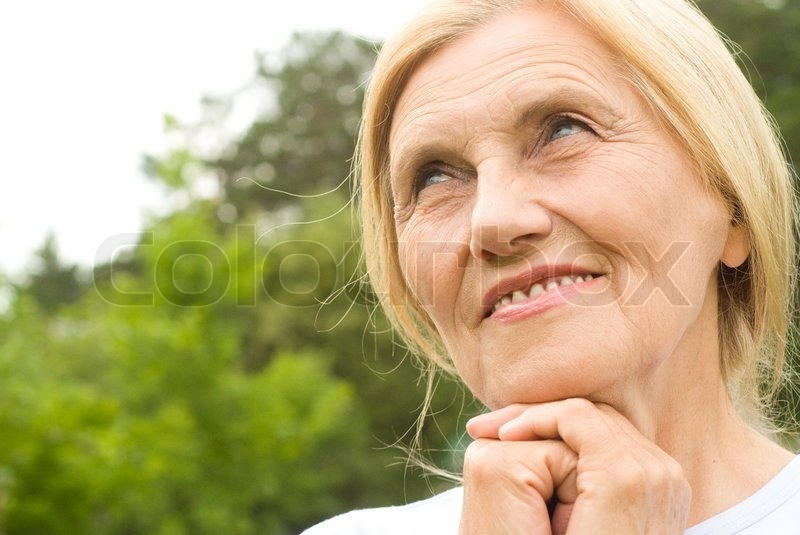 Old nice woman outside, stock photo