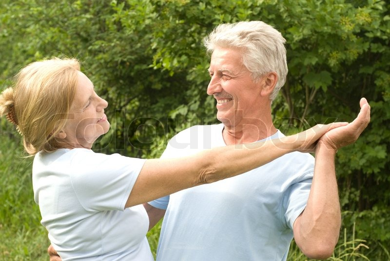 Old couple dancing, stock photo