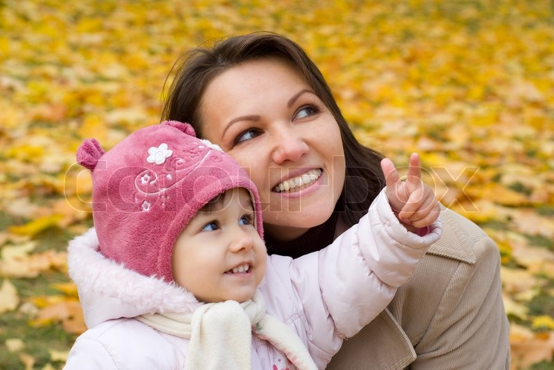Stock image of 'Mom and child at nature'