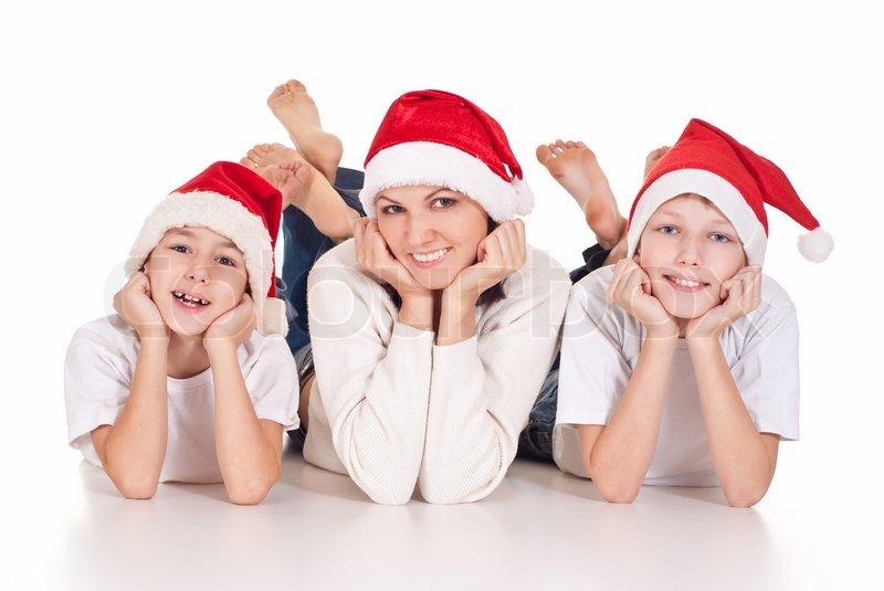 Mom and children in santa hats | Stock Photo | Colourbox