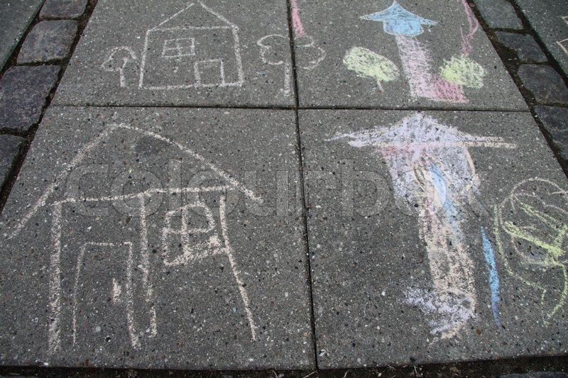 Four children chalk drawings on the tiles, stock photo