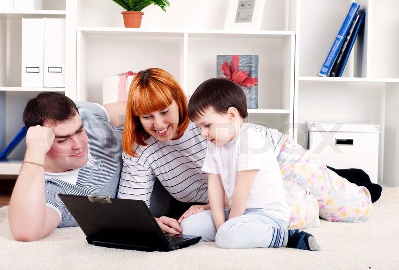 Stock image of 'Family looking at a laptop'