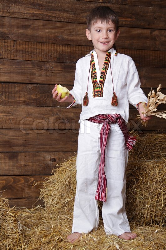 Happy young boy in traditional eastern european clothes on ...