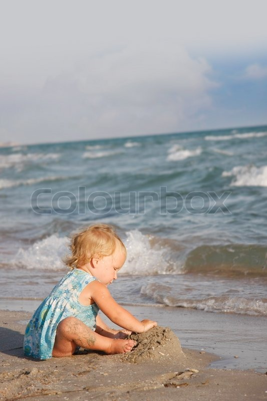 Child Playing On Beach Stock Photo Colourbox