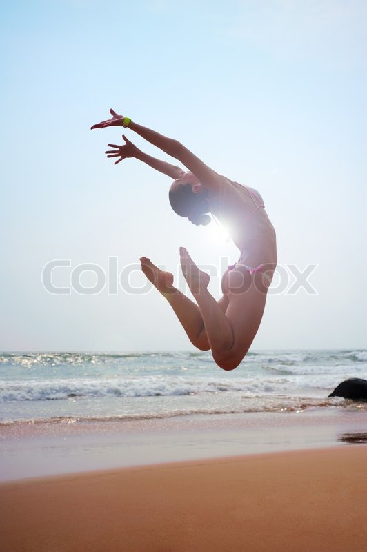 Sunny picture of jumping woman, stock photo