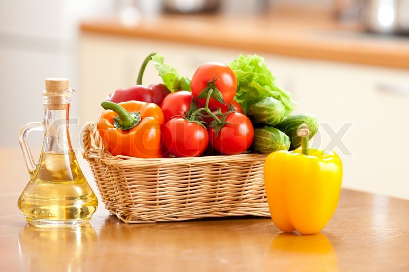 Healthy food fresh vegetables in basket and bottle with oil on the