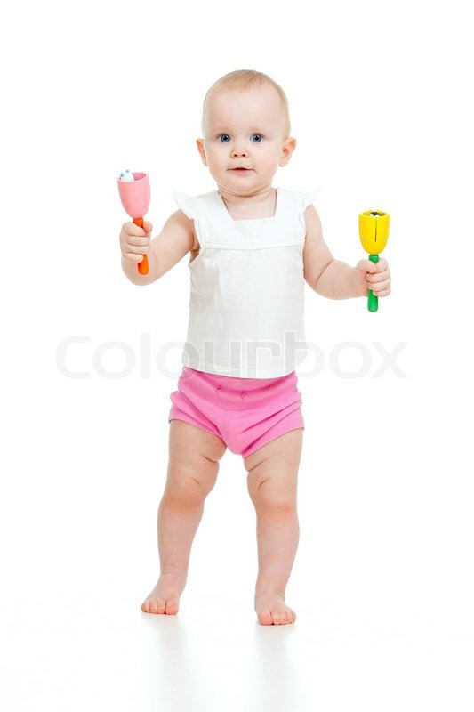 Standing baby playing with musical toy | Stock Photo ...