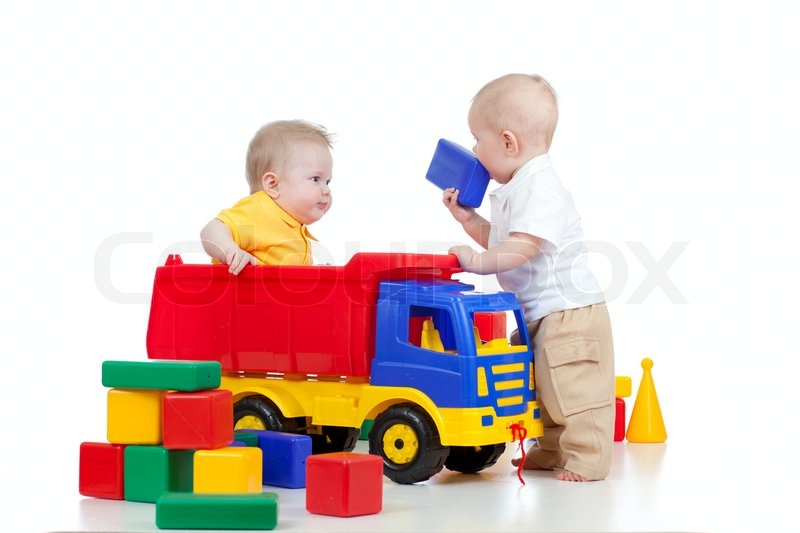 Two little children playing with color toys | Stock Photo ...