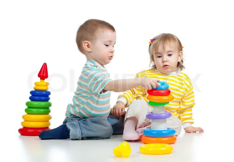Put Together Toys For Boys : Two little children playing with color toys stock photo