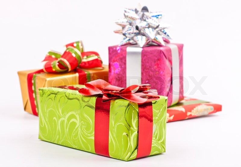 A pile of Christmas gifts in colorful wrapping with ribbons ...
