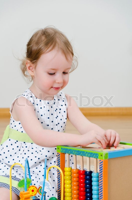 little girl playing in a developing toy stock photo colourbox. Black Bedroom Furniture Sets. Home Design Ideas