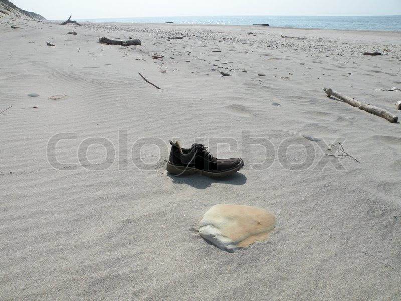 a0297851fdd0a Lost single shoe in sand on beach at ...