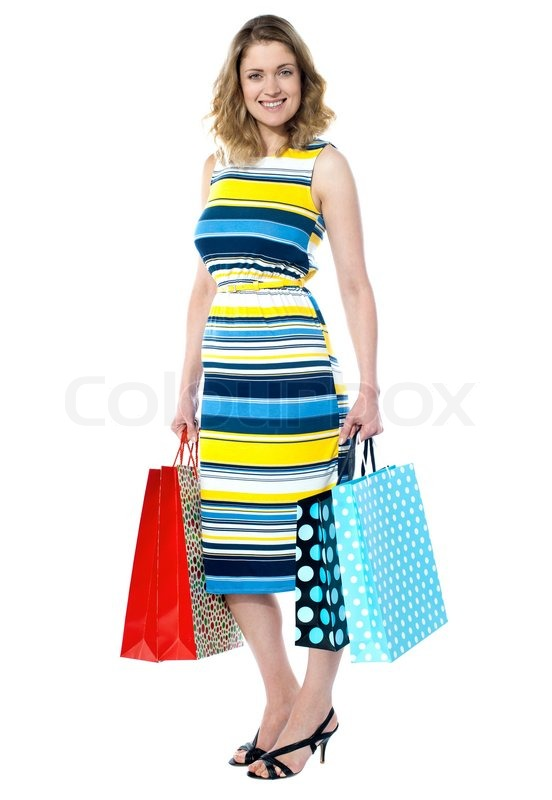 Woman holding shopping bags | Stock Photo | Colourbox