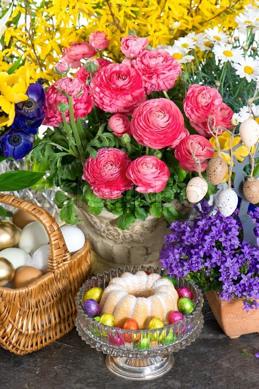 beautiful spring flowers with easter cake and eggs