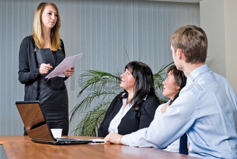 A Young Business Woman Making Presentation In An Office | Stock