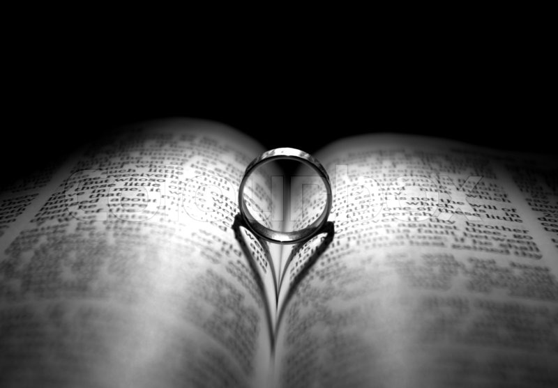 Wedding Ring and Bible Stock Photo Colourbox