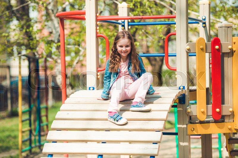 Pretty Little Girl Having Fun On A Park Stock Image Colourbox