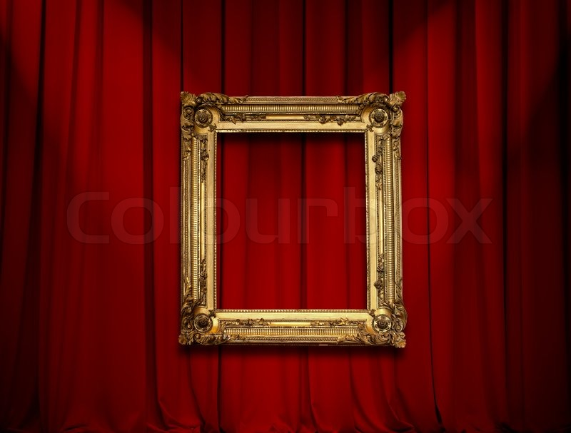 Empty Golden Painting Frame On Red Curtain Wall Stock