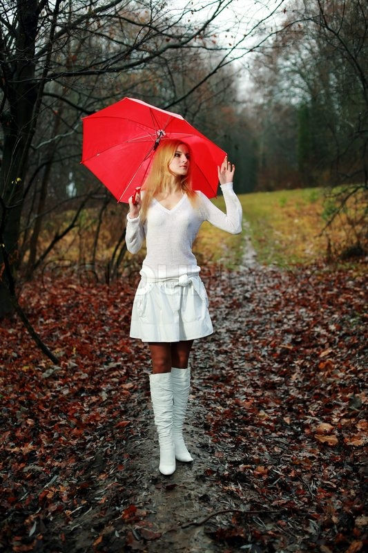 Woman With Umbrella Stock Photo Colourbox