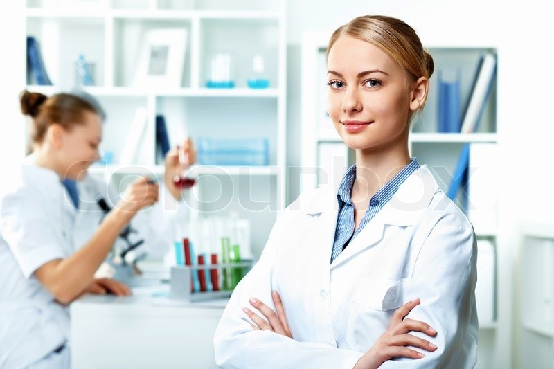 Young scientists working in laboratory, stock photo
