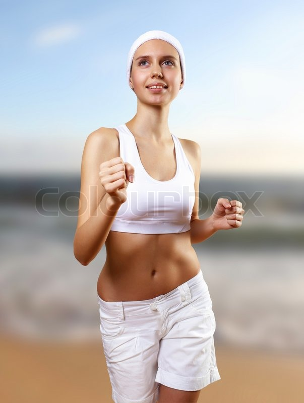 Young pretty woman in sport wear, stock photo