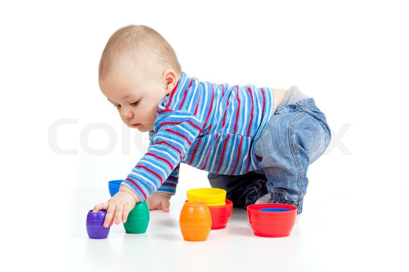 Kid Playing Wiyh Small Toys