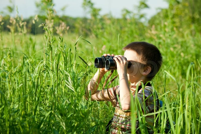 kid with binocular stock photo colourbox
