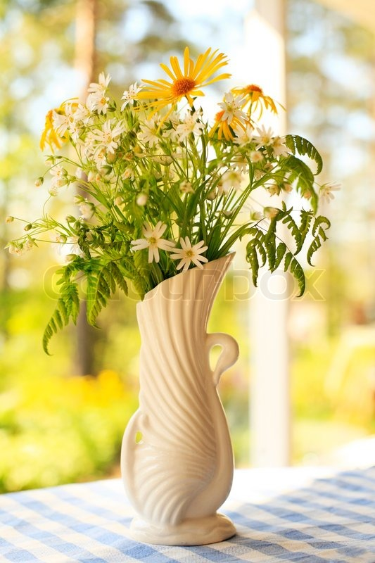 Closeup Of White Old Vase With Wildflowers In Conservatory