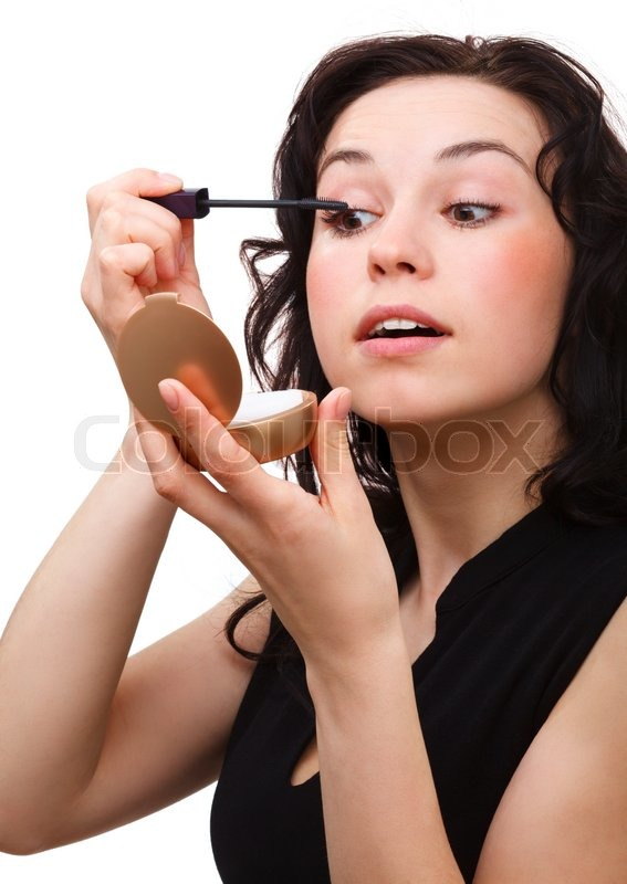 Girl Putting On Mascara