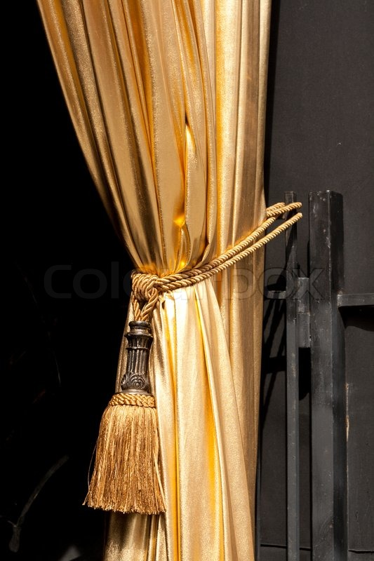 Gold Curtain With A Tassel