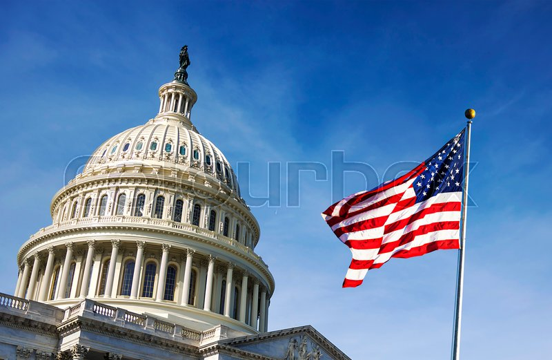 American flag waving with the Capitol     | Stock image
