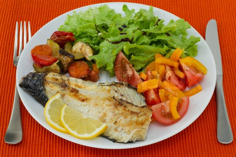 Fried fish with vegetables and salad stock photo colourbox for Fish and veggie diet