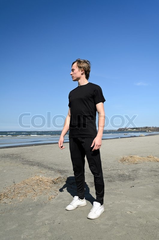 in black clothes and white shoes standing on