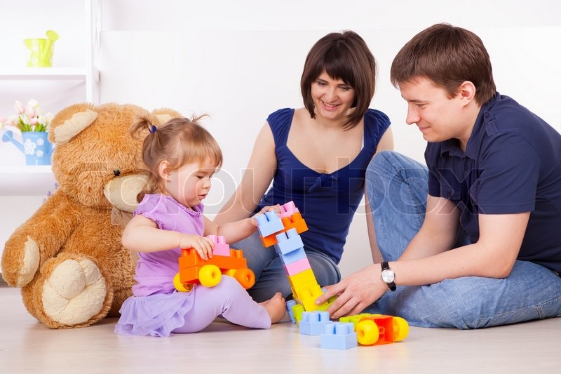 Happy parents playing with child at home stock photo colourbox thecheapjerseys Image collections