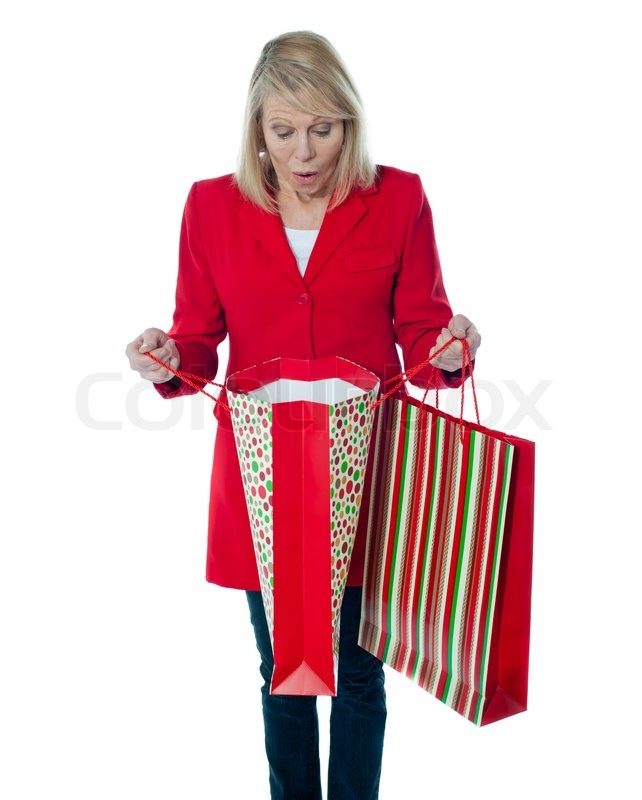 Lady surprised to see empty shopping bag | Stock Photo | Colourbox