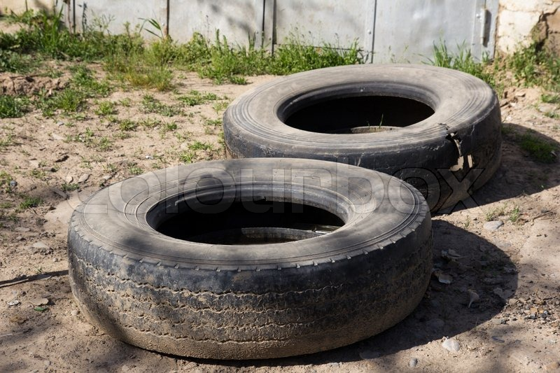 Two old tyres from the car as a background stock photo for Old tyre uses