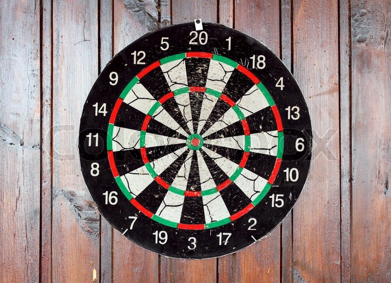 Darts against a wooden wall   Stock Photo   Colourbox